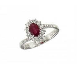 Anello fiore in oro bianco con rubino e diamanti e diamanti sul gambo