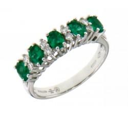 Anello rivière in oro bianco con smeraldi e diamanti